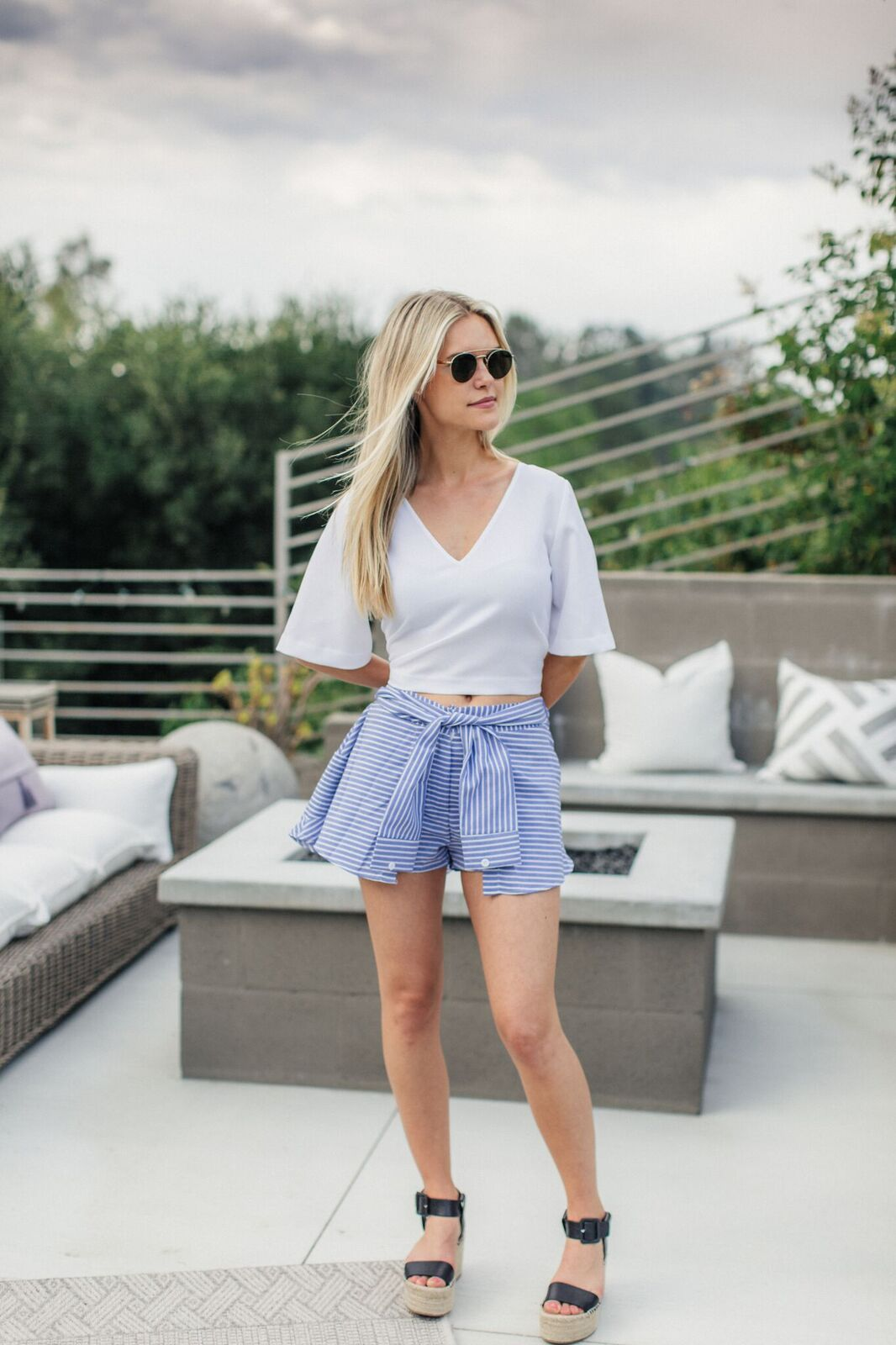 Lauren Scruggs Kennedy in white Madewell crop top and a wrap up shorts that is a skirt from Storets