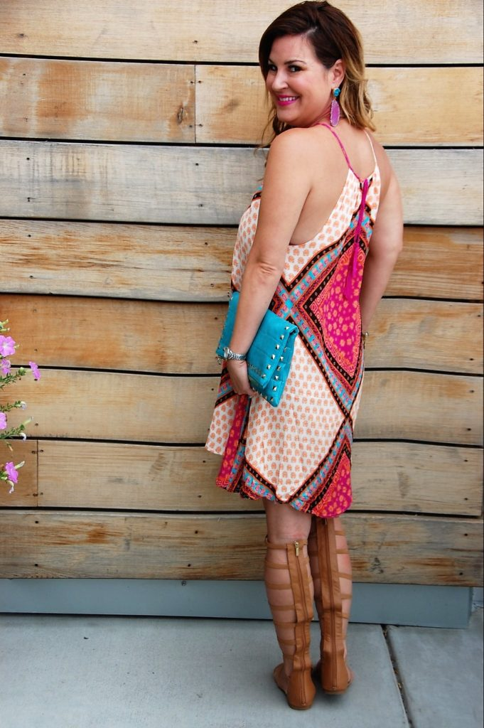 Minkpink African Trance Dress paired with aqua clutch