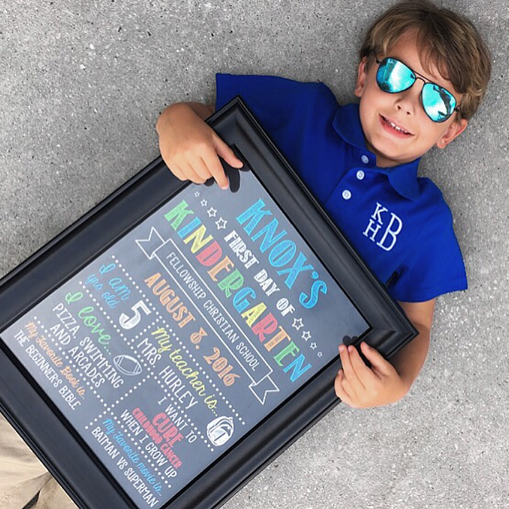 Knox Bishop in Kid's Ray Ban Blue Sunglasses with Monogram Collared Shirt holding Etsy First Day of School Sign