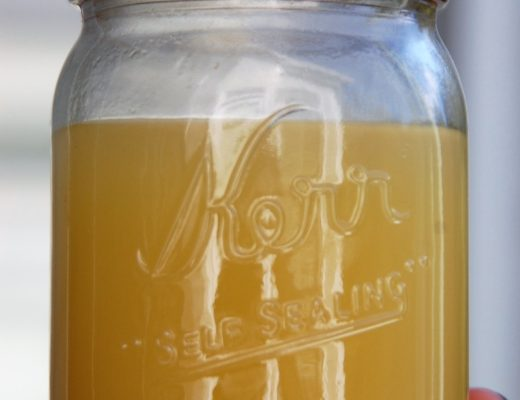 healthy crockpot chicken stock in a Kerr Mason jar by Crockpot Empire