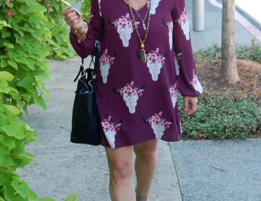 This wine colored bullhead dress with floral accents is the perfect fall mini dress. I have layered it with a black shearling vest and accessorized with a layered necklace from Fabulina Designs, a black Tory Burch York bag, and tan fringe booties.
