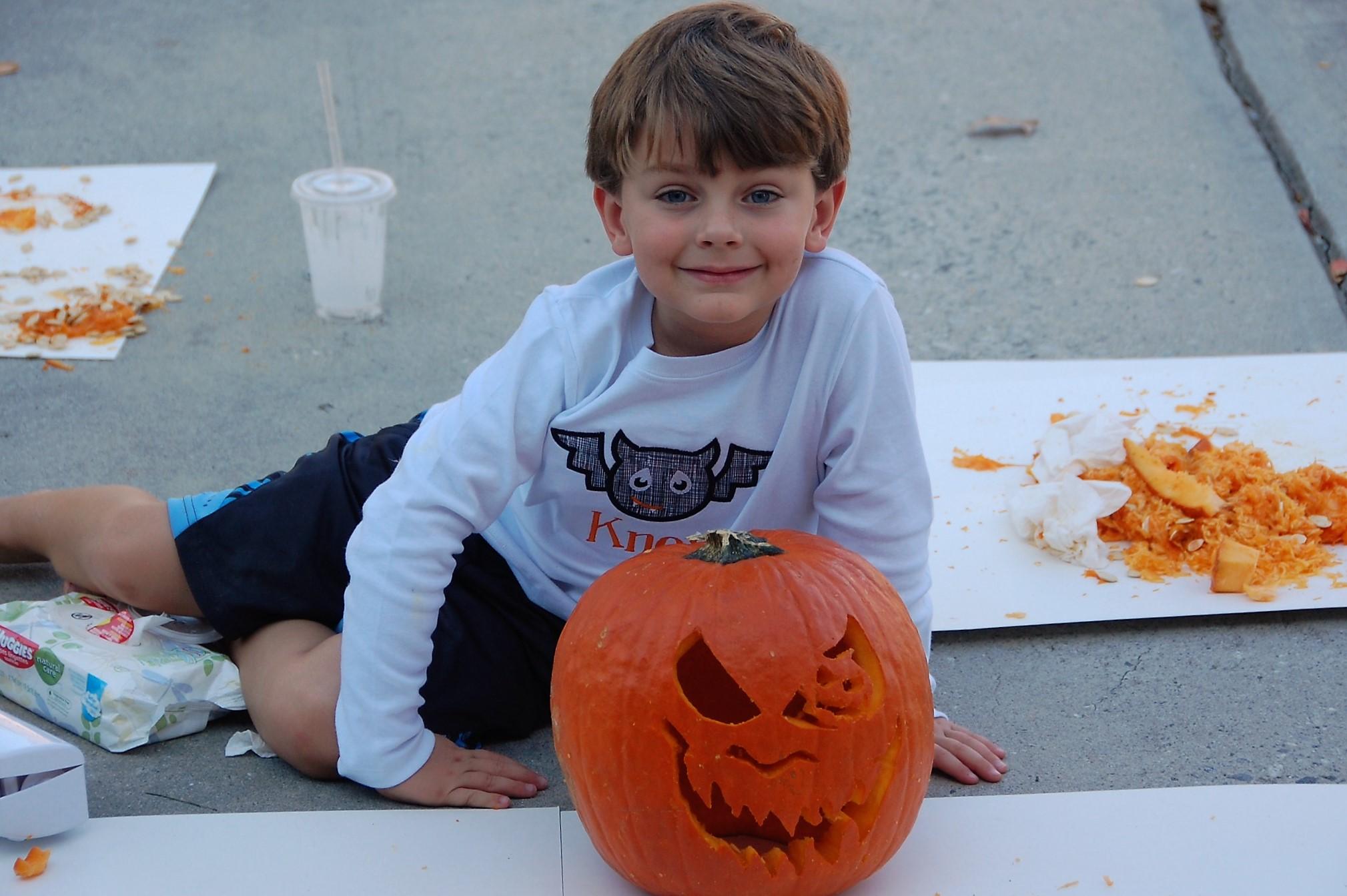 Knox Bishop carving a pumpkin for Halloween