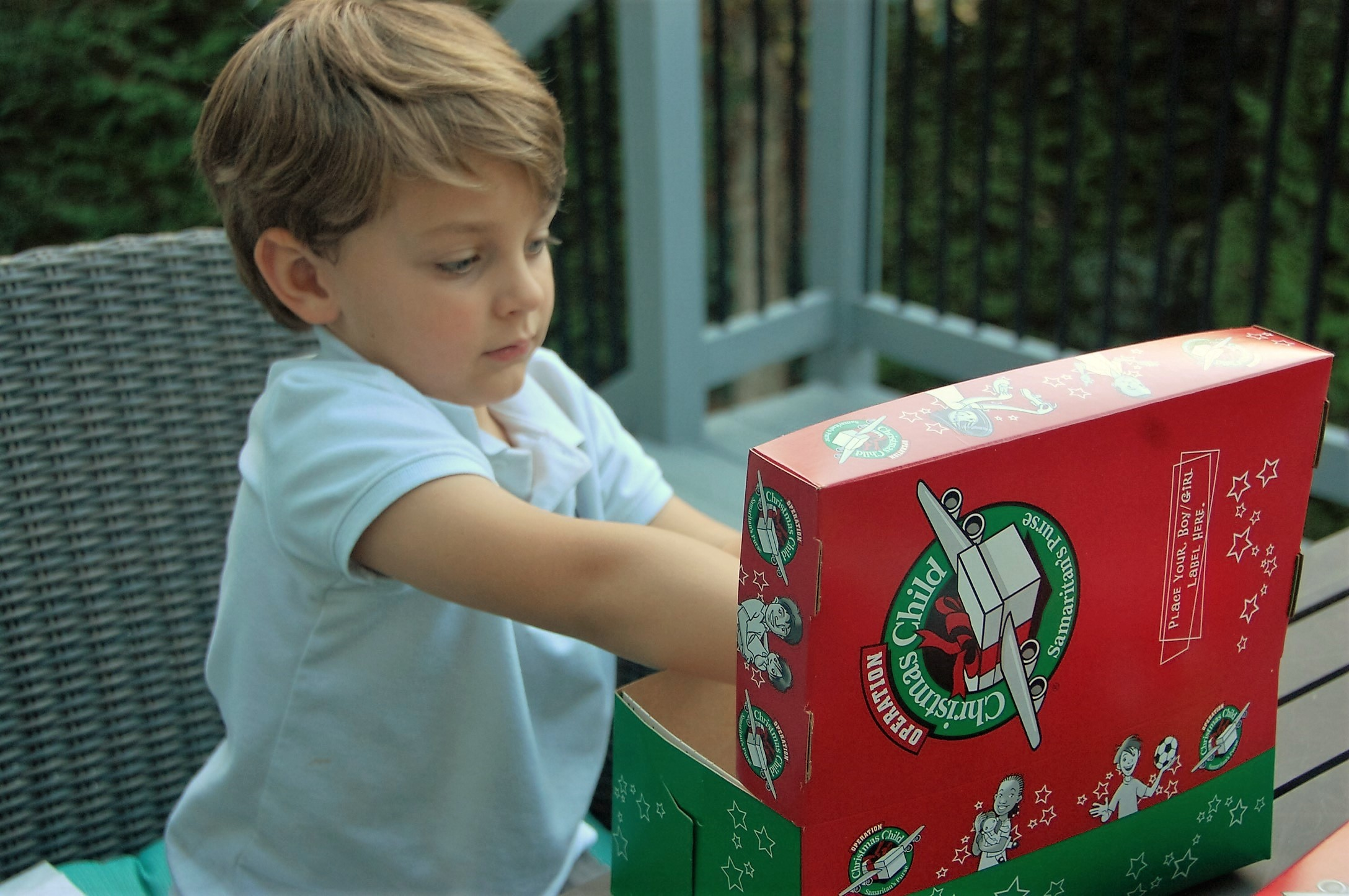 Knox Bishop fills his Operation Christmas Child Shoebox with toys for Samaritan's Purse - Crockpot Empire