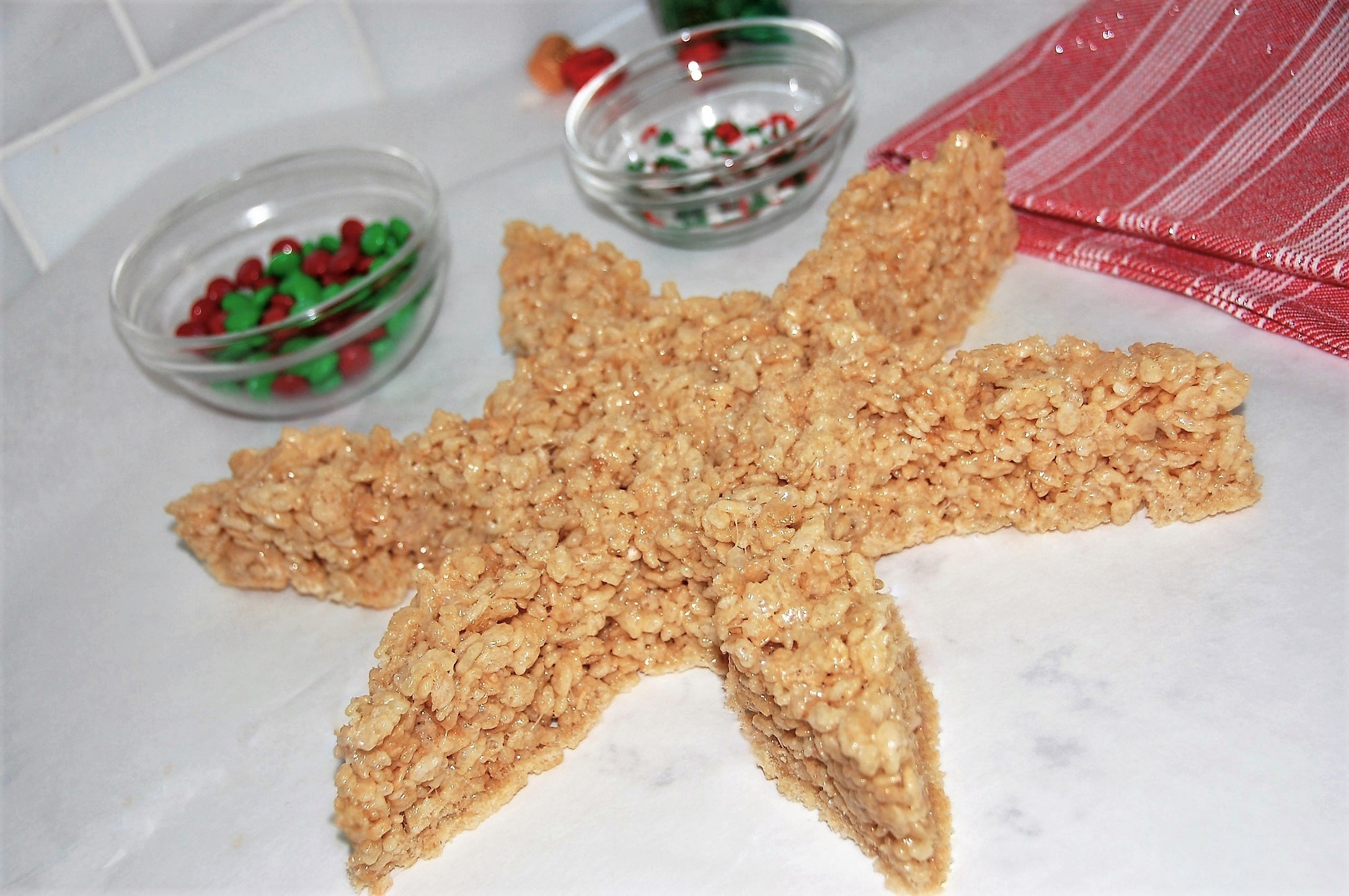 Use a giant or standard cookie cutter to make your Rice Krispies Treats into shapes like this snowflake