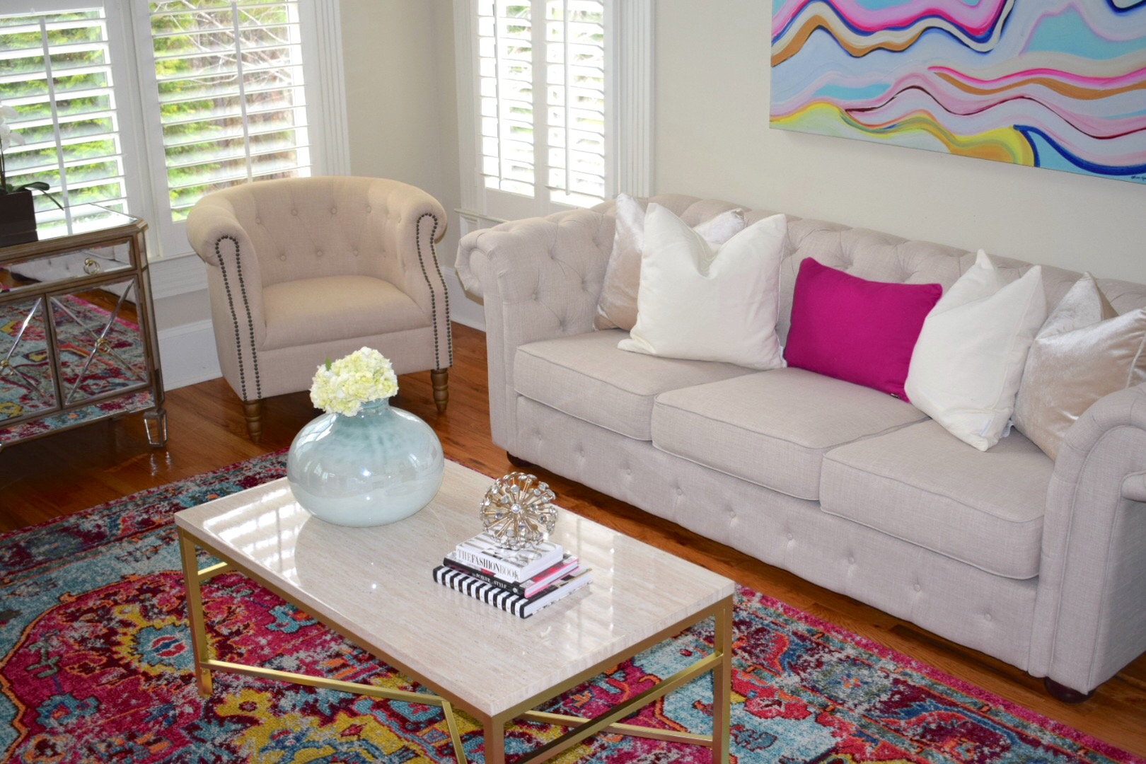 Oliver Gal Flow Abstract Wall Art in Sitting Room with Ivory Tufted Sofa and Chairs with Gold Accent Coffee Table on Pink Rug - Crockpot Empire
