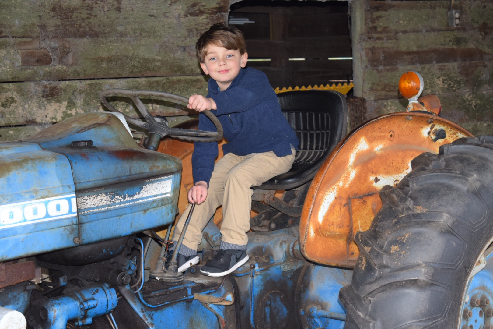New Year, Same God - Knox Bishop sitting on an old Ford tractor
