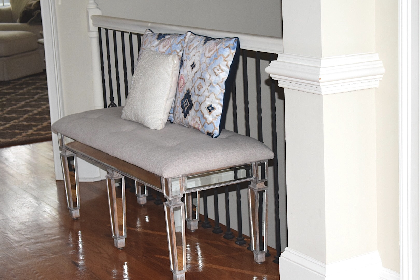 Oliver Gal Pillows on Mirrored Tufted Bench in Foyer - Crockpot Empire