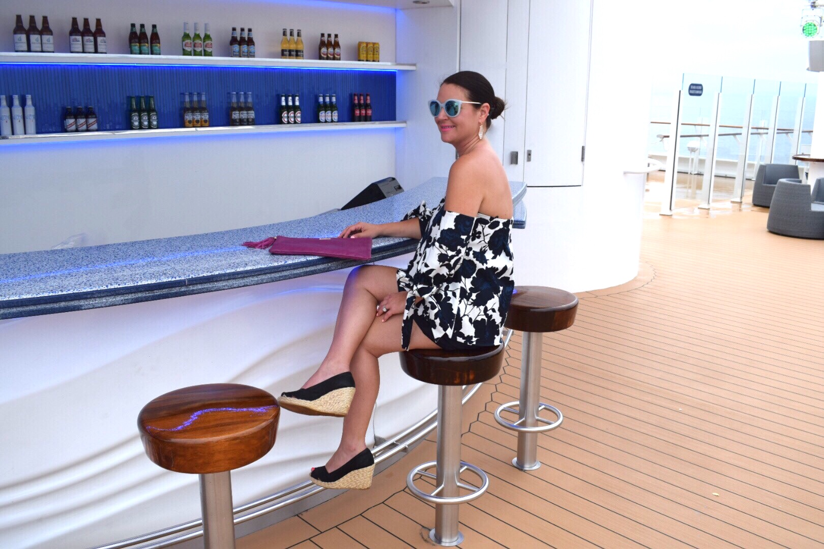 Kim Bishop at Waves Bar on Disney Dream Cruise in cat eye mirrored sunglasses and Sachin & Babi Blue Floral Off-the-Shoulder top