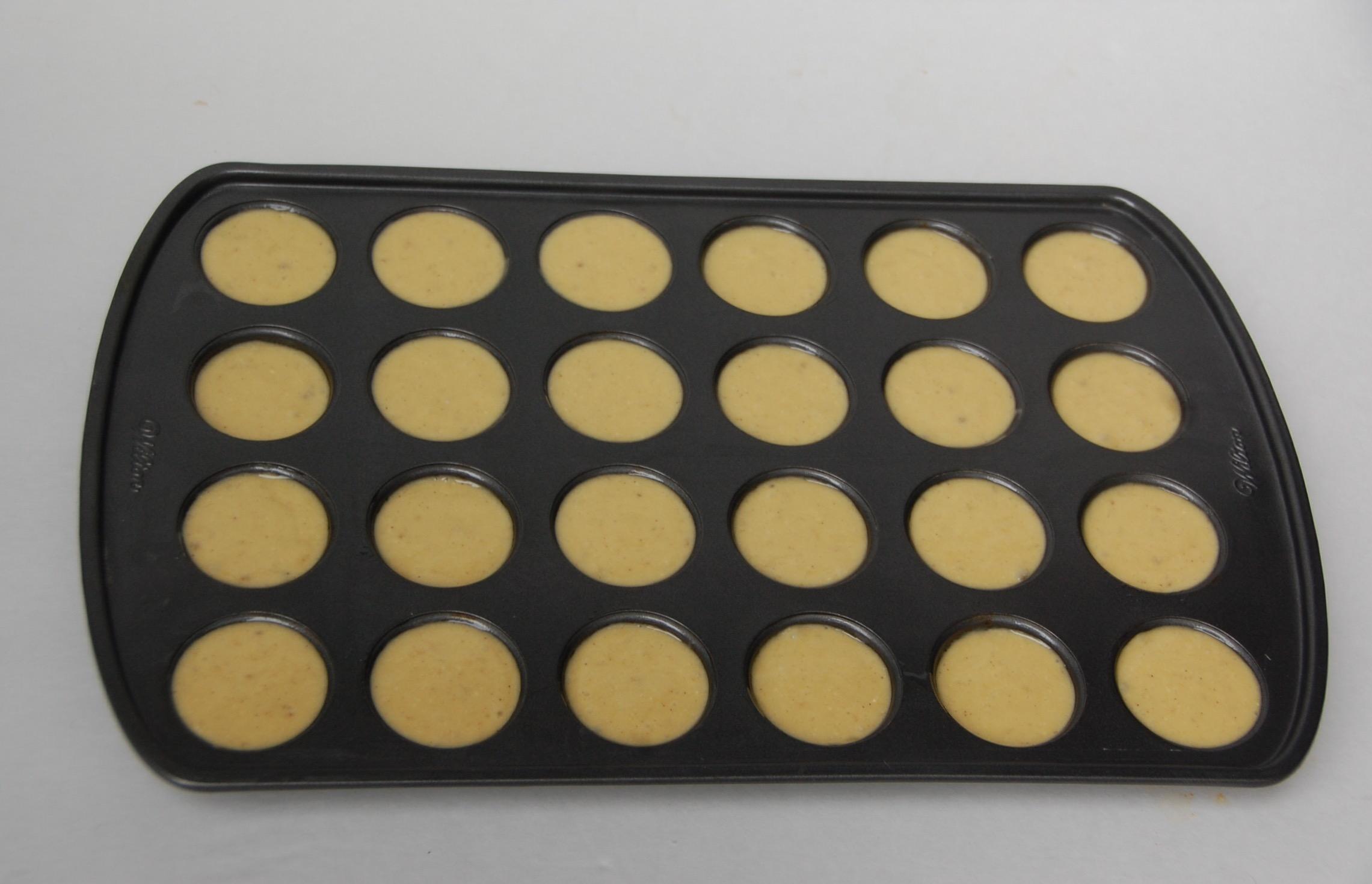 Pour Cake Batter into Mini Muffin Pan to make Banana Muffins - Crockpot Empire