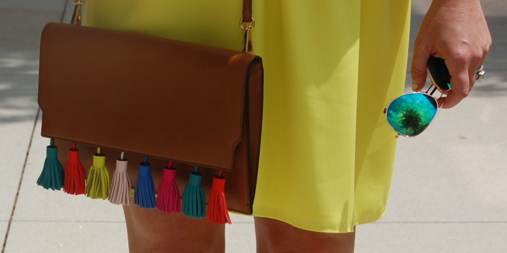 This Rebecca Minkoff Sofia Tassel Clutch is the best summer accessory and pure perfection