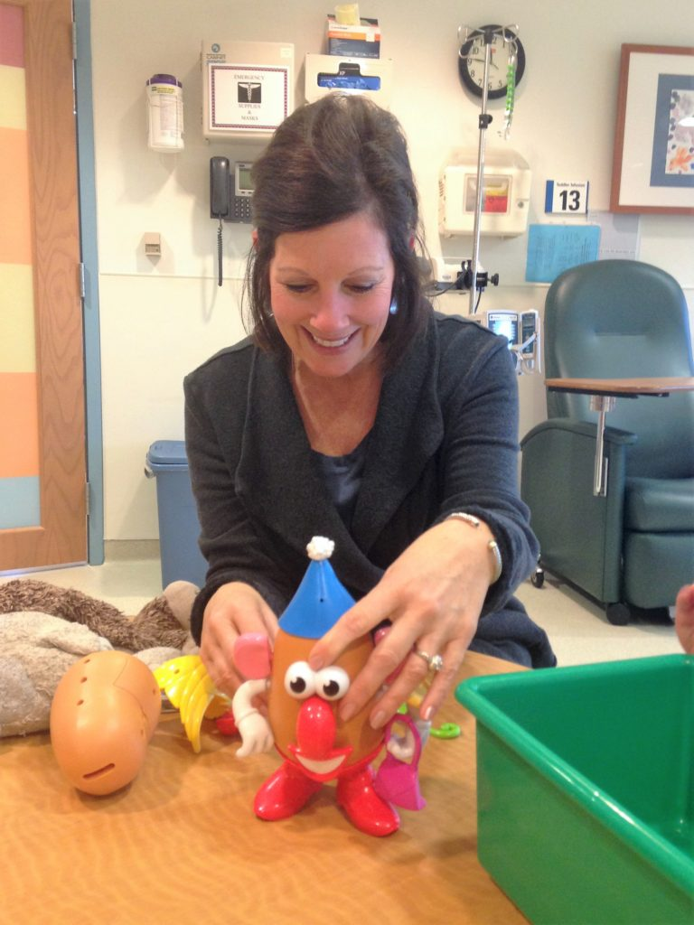 Nancy at Infusion Playing Mr Potato Head with Knox