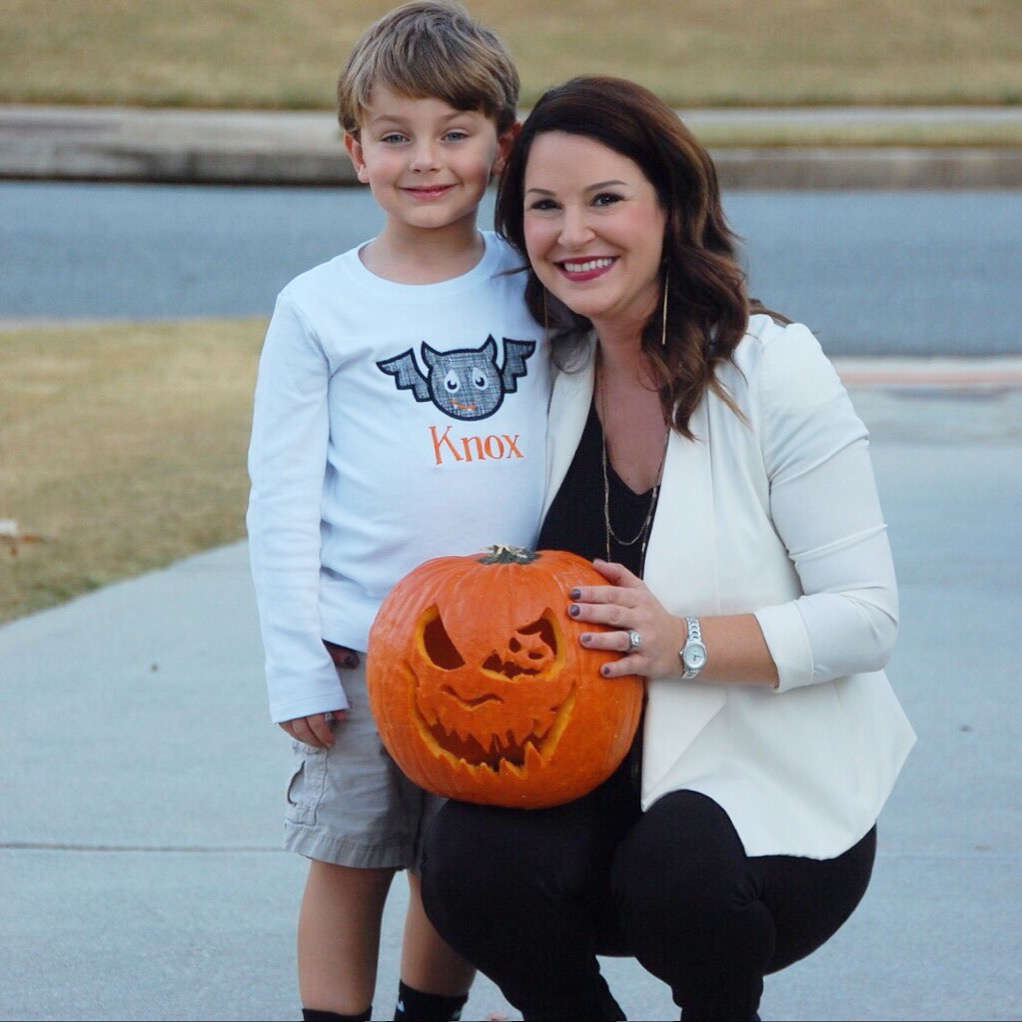 Using Pumpkin Masters tool set and templates to carve a pumpkin - Kim and Knox Bishop and Knox is wearing a monogrammed applique bat shirt