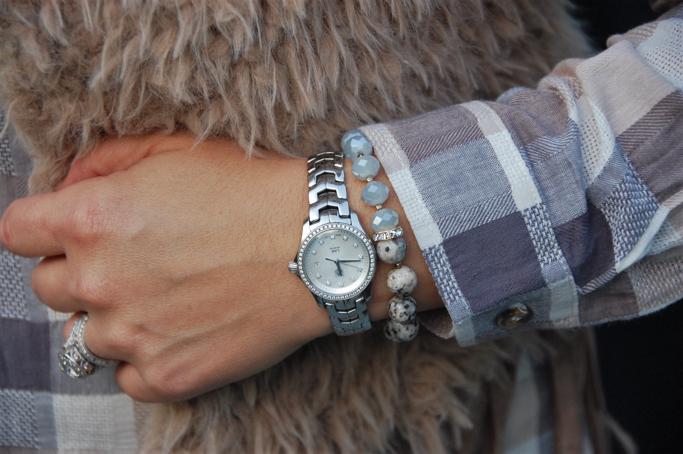 This beautiful handmade bracelet came in my Fabulous Good.com subscription box by Honey Butter Boutique. I wore it on the same hand as my Tag Heuer watch
