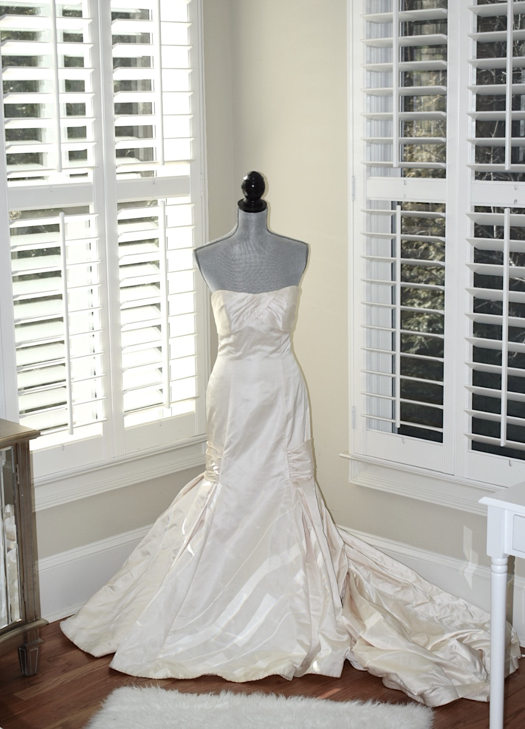 Kim Bishop from Crockpot Empire Wedding Dress on a Mannequin as decor in bedroom