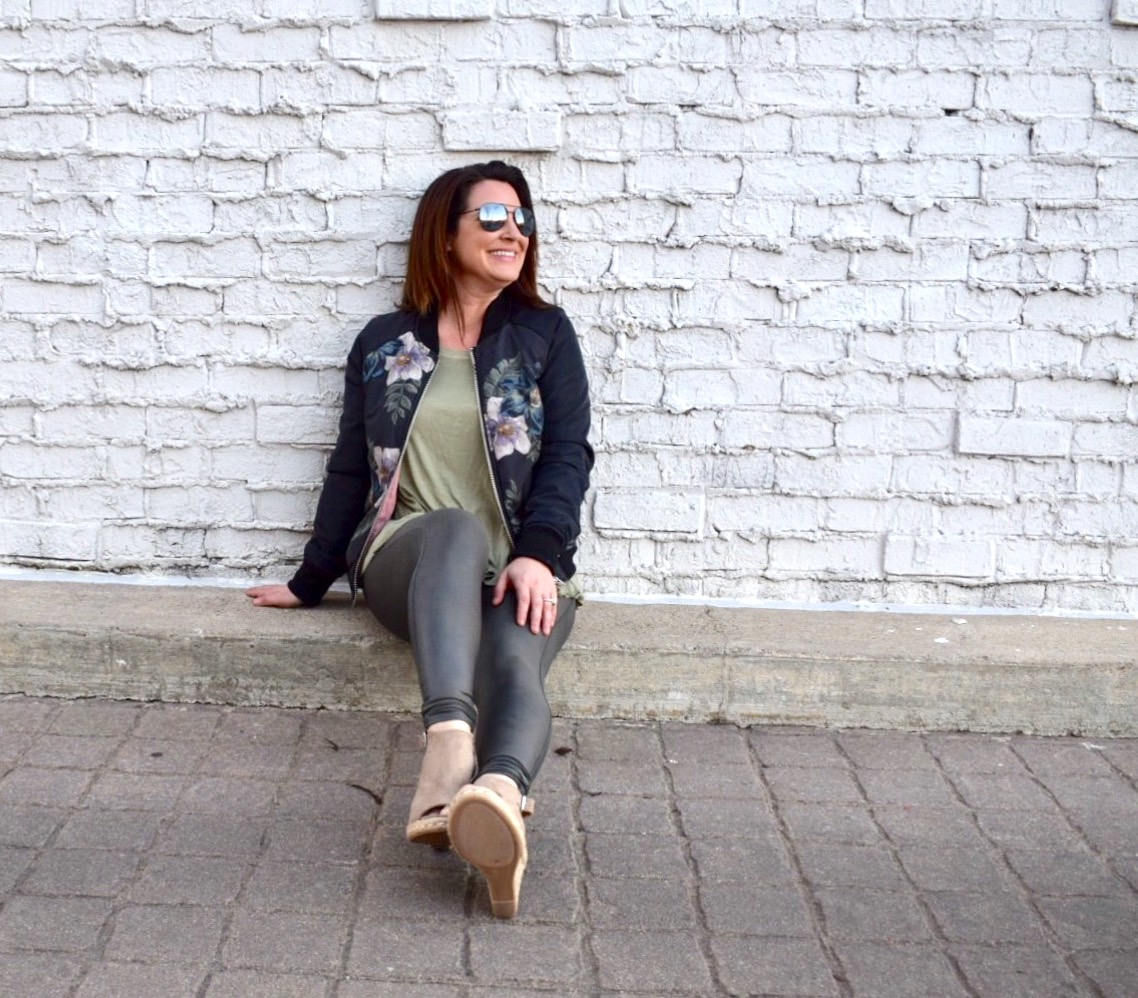 The bomber jacket in black floral print paired with olive raglan tee shirt, gunmetal Spanx and tan wedge Espadrilles