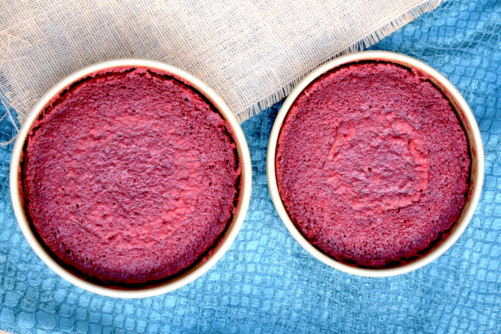 Two Williams Sonoma gold touch round cake pans with red velvet cake by Crockpot Empire